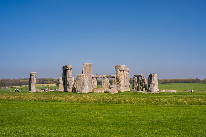 Stonehenge Memorial UNESCO World Heritage Site Ancient Ancient Civilization Archaeology Architectural Column Architecture Built Structure Copy Space Day Field Grass History Land Nature No People Old Ruin Outdoors Plant Ruined Stone Material The Past Tourism Travel Travel Destinations