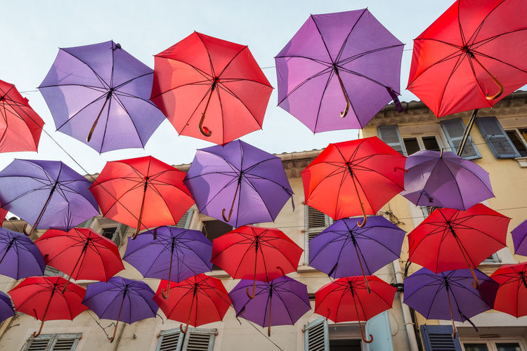 Low angle view of multi colored umbrellas hanging on clothesline
