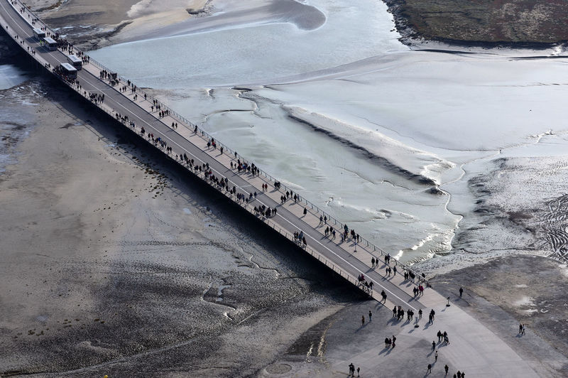 View from the Mont Saint Michel, France Partner Collection EyeEm Partner Selection Low Tide Reflections In The Water Bridge Over Water Travel Land Ice Water White Color Beauty In Nature Scenics - Nature Aerial View Outdoors Mode Of Transportation Nature No People Transportation Day High Angle View Cold Temperature