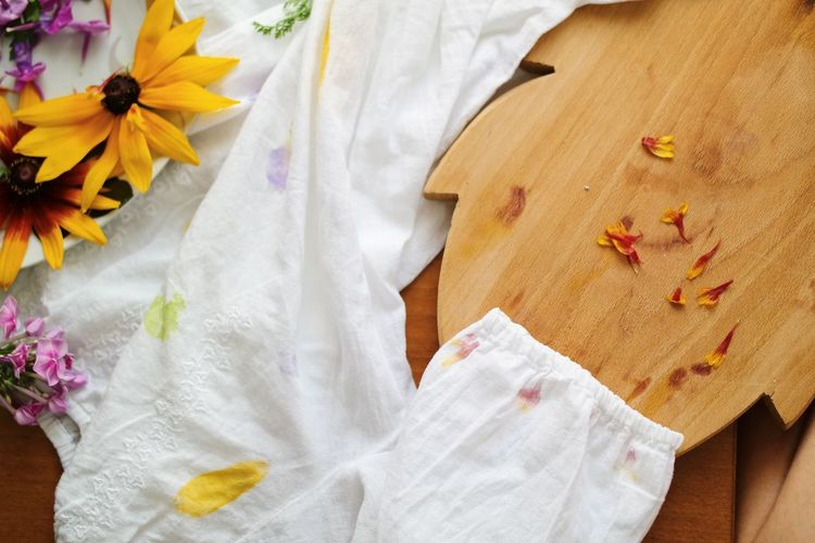 High angle view of white flowers on bed