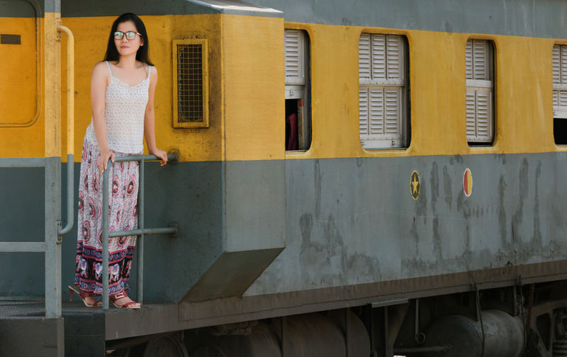 Adult Adults Only Beautiful Woman Beauty Cultures Day Eyeglasses  Front View Full Length Glamour Lifestyles One Person One Woman Only Only Women Outdoors People Portrait Skirt Sleeveless  Smiling Standing Train Travel Women Live For The Story Paint The Town Yellow