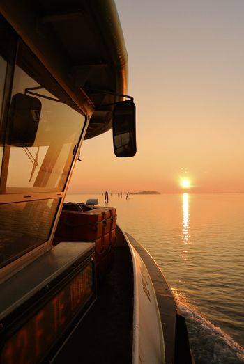 Scenic View Of Sea Seen Through Boat During Sunset