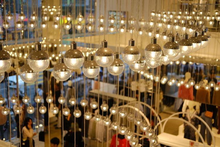 Row of illuminated lights hanging in restaurant