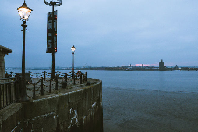 River Mersey River Mersey Waterfront Liverpool Liverpool, England Liverpool Waterfront Liverpool Docks Liverpool England Water Street Light Sky Lighting Equipment Built Structure Street Architecture Building Exterior Nature Sea Railing No People Day Dusk Outdoors Illuminated Cloud - Sky City Light