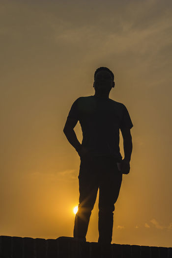 Silhouette One Man Only Only Men Standing One Person Adults Only Adult Men Sunset People Yellow One Young Man Only Sport Full Length Outdoors Night Headwear Portrait Sportsman Sky