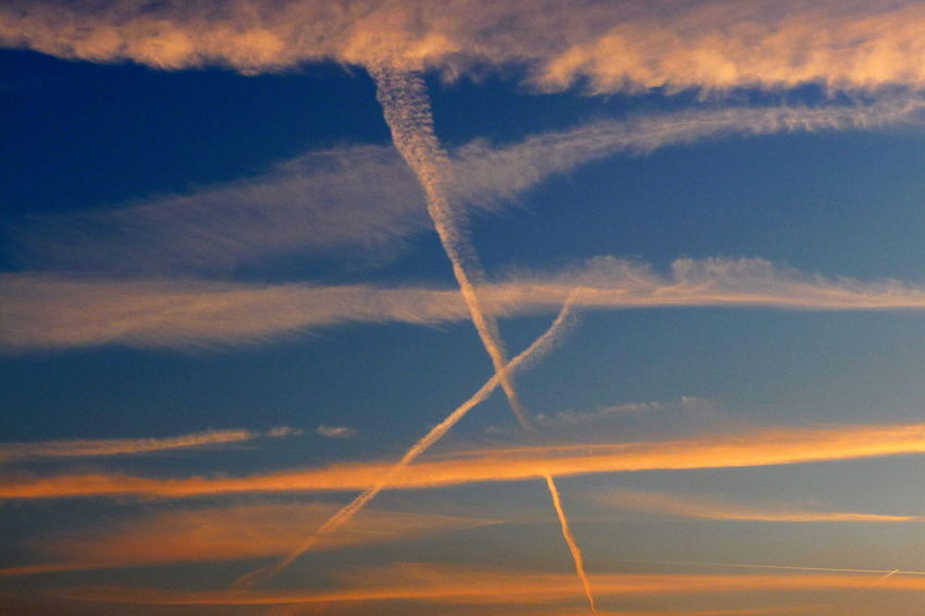 Cross In The Sky Beauty In Nature Blue Contrail Day Evening Sky Evening Sky Shot Low Angle View Nature No People Outdoors Scenics Sky Vapor Trail
