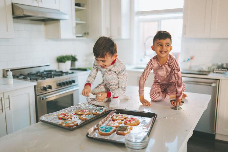 Cute kids preparing cookies at home