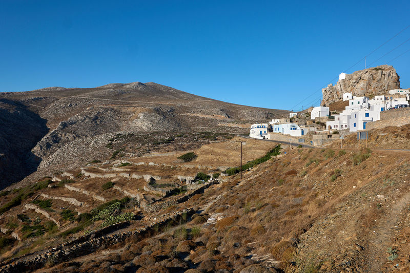 Amorgos Amorgos Architecture Arid Climate Blue Building Building Exterior Built Structure Clear Sky Climate Copy Space Day Environment Greece House Land Landscape Mountain Mountain Range Mountains Nature No People Outdoors Residential District Scenics - Nature Sky