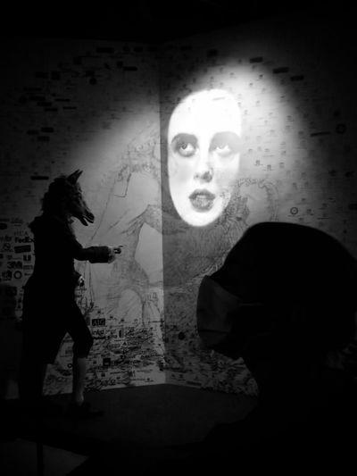 Portrait of couple standing in dark room