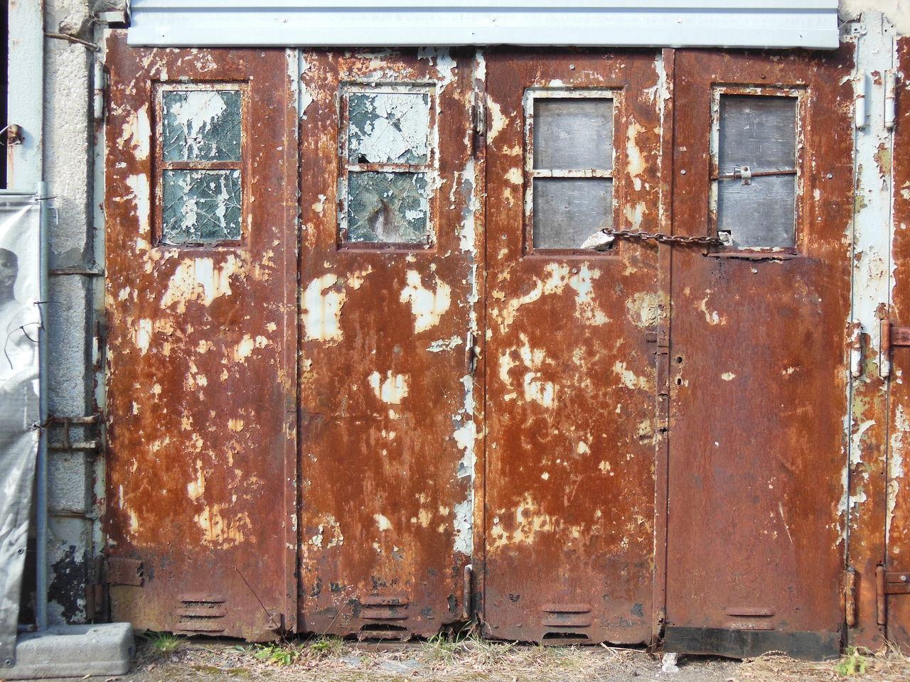 OLD RUSTY DOOR OF BUILDING