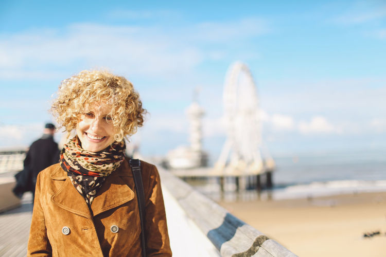 Adult Autumn Beach Beautiful People Beauty Blue Sky City Clouds Curly Hair De Pier Ferris Wheel Girl One Person One Woman Only Only Women People Pier Portrait Sand Scarf Sea Seaside Sunny Women Young Adult Connected By Travel Connected By Travel Moments Of Happiness