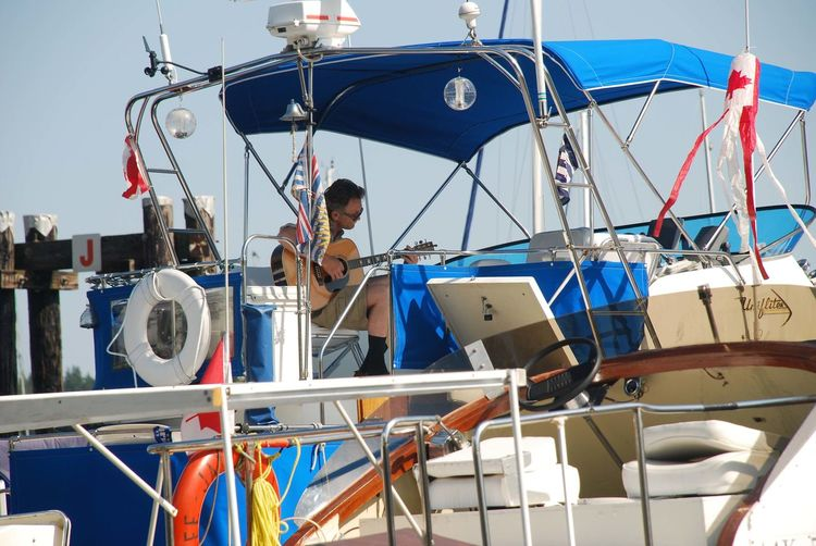 Guitar Player On Boat Harbour View Nanaimo BC Day Full Length Guitarist Moored Nautical Vessel One Person Outdoors People Real People Skill  Sky Standing