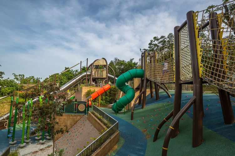 Playground - Admiralty Park. Modern loops, twirls and slides Architecture Building Exterior Built Structure Child Childhood Cloud - Sky Day Jungle Gym Nature Outdoor Play Equipment Outdoors Plant Playground Real People Sky Slide Slide - Play Equipment Swimming Pool Tree Water Water Slide