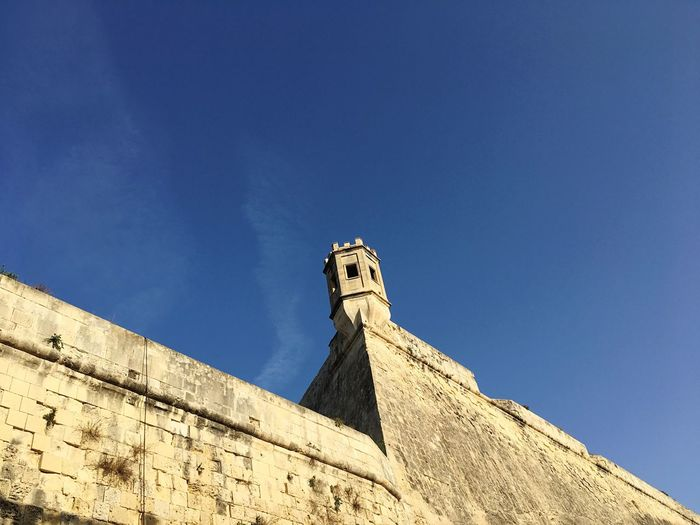 Low Angle View Of Lookout Tower On Fort At Floriana Against Blue Sky