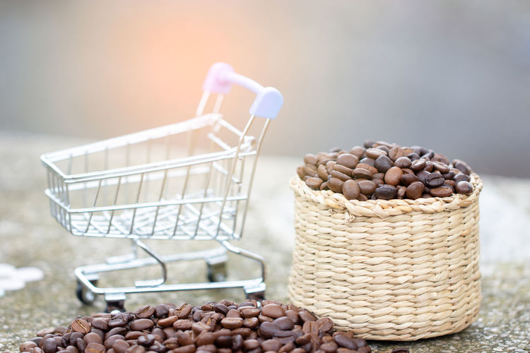 Beans Coffee Sale Agriculture Basket Brightly Lit Close-up Container Day Focus On Foreground Food Food And Drink Freshness Healthy Eating Heap Large Group Of Objects Lens Flare Nature No People Selective Focus Still Life Sunlight Table Wellbeing
