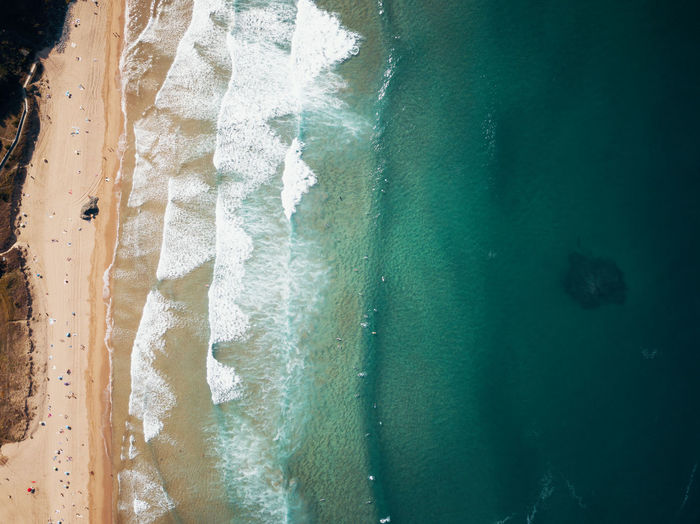 High angle view of beach with waves coming in