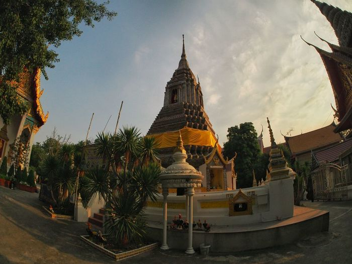 Panoramic view of temple and buildings against sky