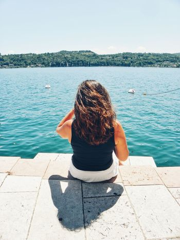 Water Sitting Long Hair Adult Sea People Relaxation Summer Outdoors Nature Day Beach Sky River Lake Enjoying Nature Looking At The Sea Tranquility Holidays Vacations Sun Sunny Looking At Nature Woman Sitting In The Sun Sommergefühle