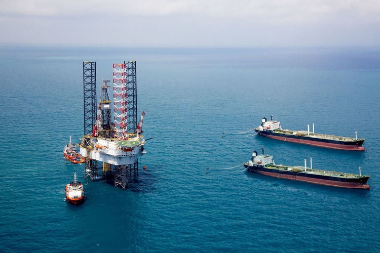 Oil rig in the sea Gas Offshore Crude Oil Day Diesel Drilling Rig Fossil Fuel Fuel And Power Generation High Angle View Industry Mode Of Transportation Nature Nautical Vessel Offshore Platform Oil Oil Industry Outdoors Petroleum Pollution Scenics - Nature Sea Sky Tanker Ship Transportation Water