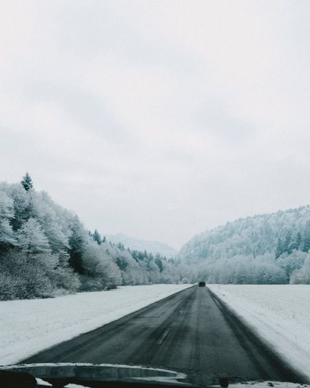 Transportation Car Road Windshield Snow Motor Vehicle The Way Forward Direction Vehicle Interior Mode Of Transportation Winter Nature Transparent Glass - Material No People Tree Cold Temperature Mountain Sky Plant
