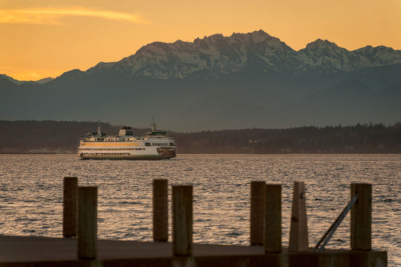 Seattle Sunset. A Seattle ferryboat makes the crossing to Bremerton, Washington, during a beautiful spring sunset.over the Olympic Mountains. Beauty In Nature Boat Bremerton BremertonFerry Commute Commuting Landscape Mode Of Transport Mountain Mountain Range Nature Nautical Vessel Non-urban Scene Olympic Mountains Pacific Northwest  Puget Sound Salish Sea Scenics Sea Seattle Seattle, Washington Sky Sunset Transportation Water