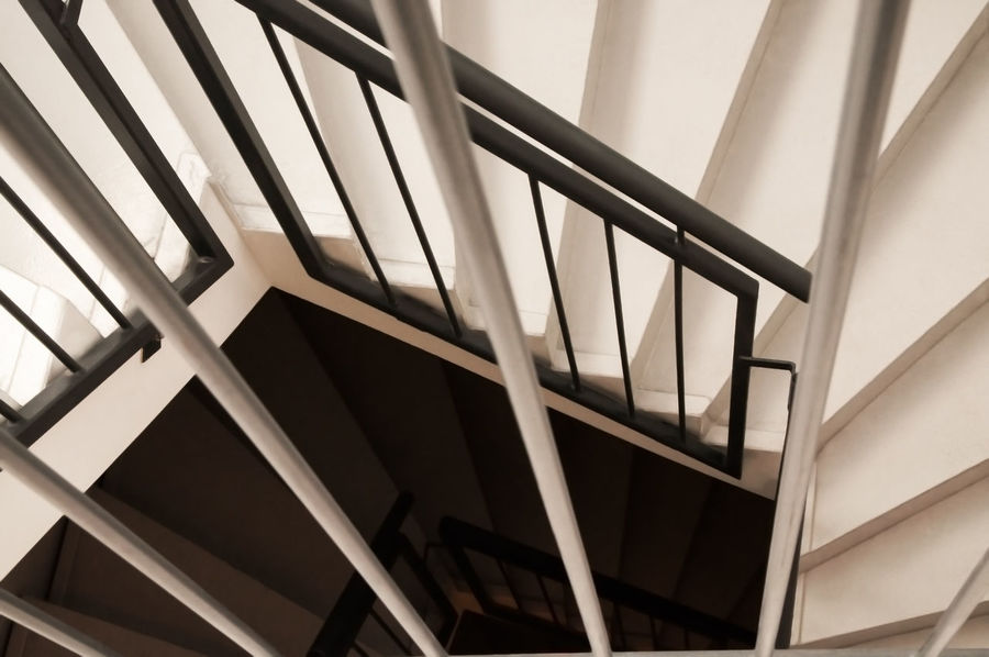 Looking down on a modern, black and white spiral staircase Exercise Lines Looking Down Stairs Stairway Steps Descend Dizzy Downstairs Escape Evacuation Exit Patience Rise Safety Spiral Stair Staircase Step Step By Step Swirl Top View Twirl Up Winding