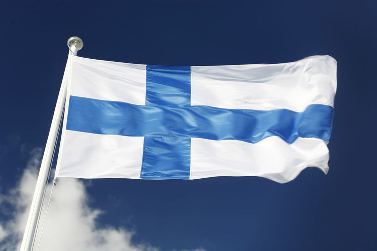 The National flag of finland waving in the wind.