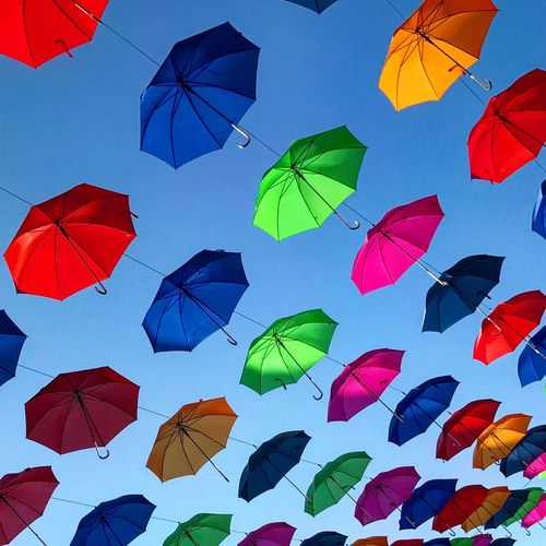 Clear Sky Colors Diagonal Lines Red Umbrella Blue Blue Umbrella Coloful Colorful Umbrella Colorful Umbrellas Decoration Green Umbrella Hanging Umbrellas Low Angle View Multi Colored Orange Umbrella Outdoors Parallel Protection Rain Sky And Umbrellas Umbrella Umbrella Revolution Umbrellas Variation