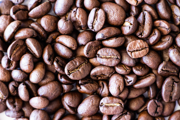 Abundance Backgrounds Brown Caffeine Close-up Coffee Coffee - Drink Coffee Bean Drink Food Food And Drink Freshness Full Frame Heap Large Group Of Objects Refreshment Roasted Coffee Bean Still Life