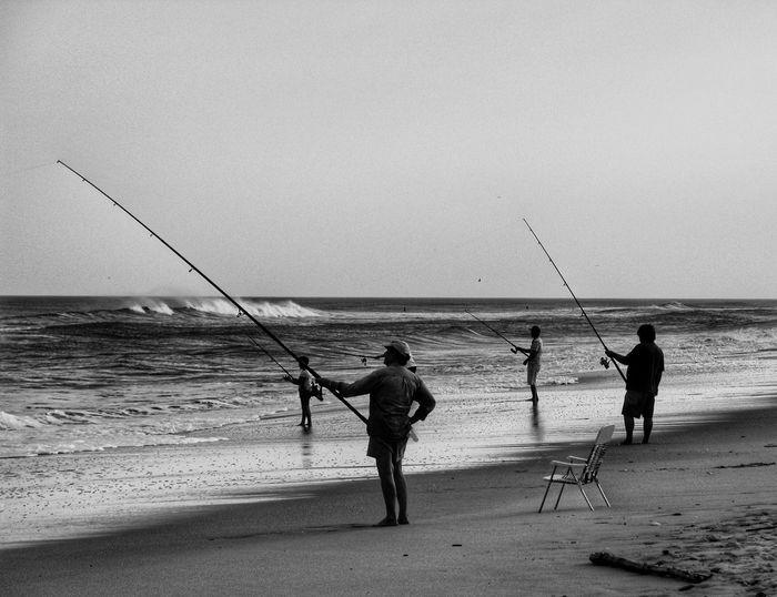 Sea Beach Water Fishing Horizon Over Water Sand Fishing Pole Fishing Rod Shore Full Length Nature Real People Fishing Equipment Tranquil Scene Men Beauty In Nature Weekend Activities Scenics Standing New Jersey Beach