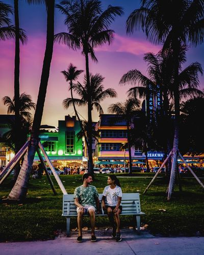 Couple Couple Travelling Travel Couple Miami, FL Colourful Man Miami Beach Miami Miami South Beach Art Deco Sunset Art Deco District Tree Child Togetherness Men Full Length Bonding Childhood Girls Dog Friendship Silhouette Orange Color Evening Skyline Swing Hugging Shore Outline