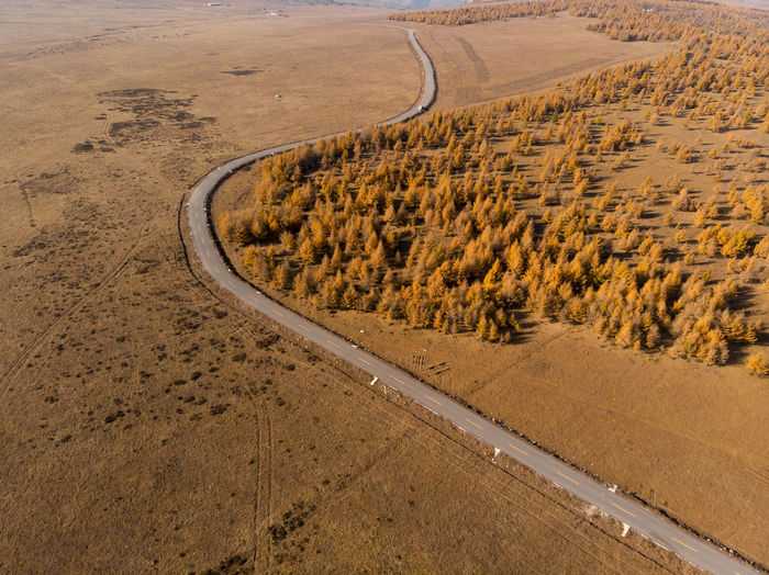 High angle view of road passing through desert
