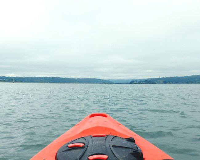 Close-up of kayak on sea against sky