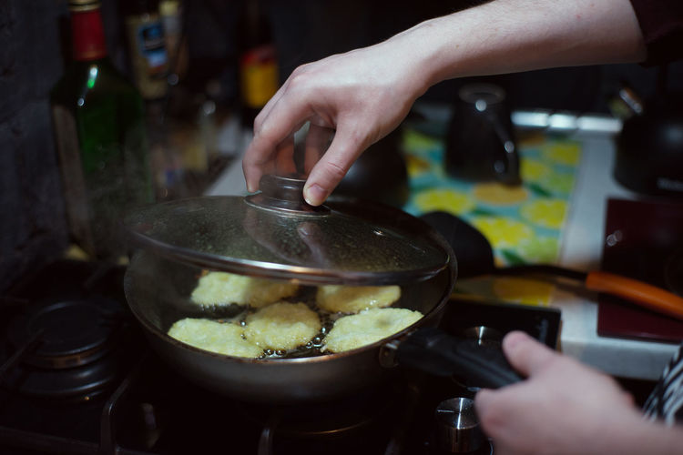 Midsection of person preparing food in kitchen