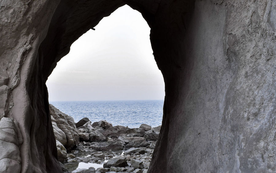 Beach Beach Photography Beauty In Nature Beauty In Nature Cave Cloud - Sky Coastline Day Grey Sky Horizon Over Water Natural Arch Nature Nikon Nikon D3300 No People Outdoors Rock - Object Scenics Sea Sea And Sky Seascape Sky Water Window Winter