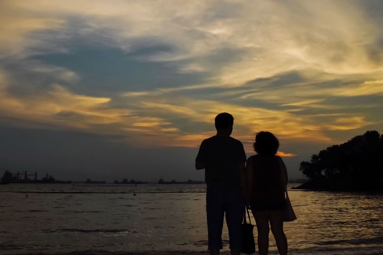 Sunset Silhouette Sky Two People Sea Togetherness Beach Water Nature Cloud - Sky Love Real People Beauty In Nature Scenics Outdoors Lifestyles Men Standing Leisure Activity Bonding Lovers Sentosa Sentosa Island, Singapore Embracing Couple - Relationship