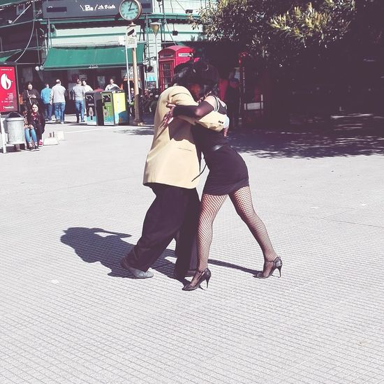 Tangoargentino Real People Full Length Street Day City Street Outdoors Shadow Lifestyles Adult Headwear Sunlight City Sky Tango Streetdancing