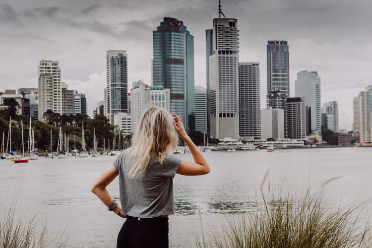 The City Australia Brisbane Brisbane City Architecture Back View Of Girl Blond Hair Brisbane Australia Building Exterior Built Structure City Cityscape Day One Person Outdoors Person Queensland Real People River Sky Skyscraper Standing Water Women