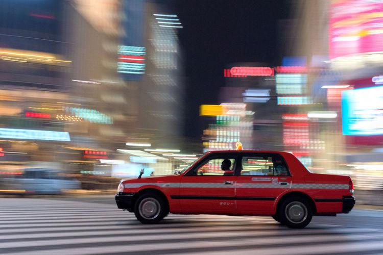 Blurred motion of car on illuminated city street