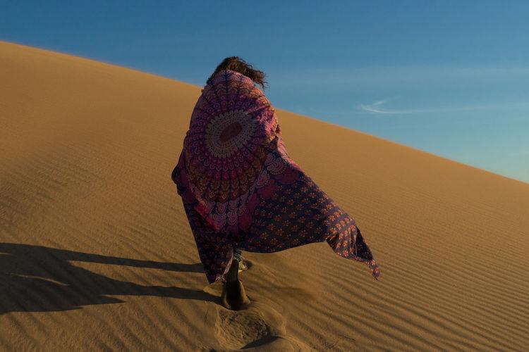 Full length of woman in desert against clear sky