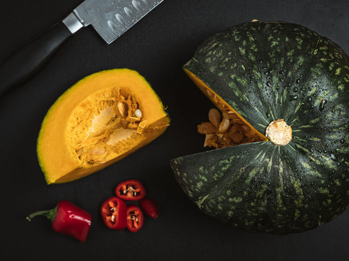 High angle view of pumpkin on table against black background