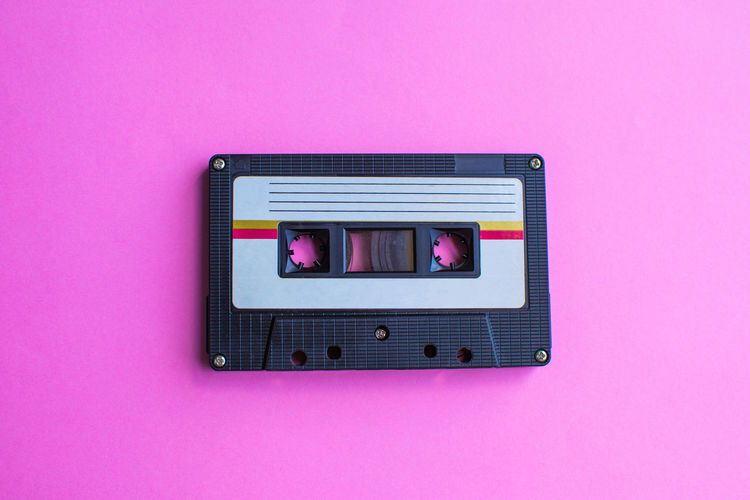 Tape Cassette Retro Old Vintage Pink Color Technology Pink Background Indoors  Close-up No People Communication Copy Space Purple Connection Retro Styled Wall - Building Feature Studio Shot Colored Background Electricity  Still Life Text Directly Above Music