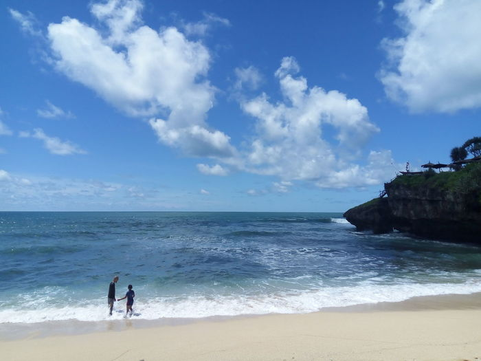 Sea Beach Horizon Over Water Sand Sky Two People Wave Walking Full Length Vacations Water Day Cloud - Sky Nature Beauty In Nature Adult Outdoors People Men INDONESIA Yogyakarta
