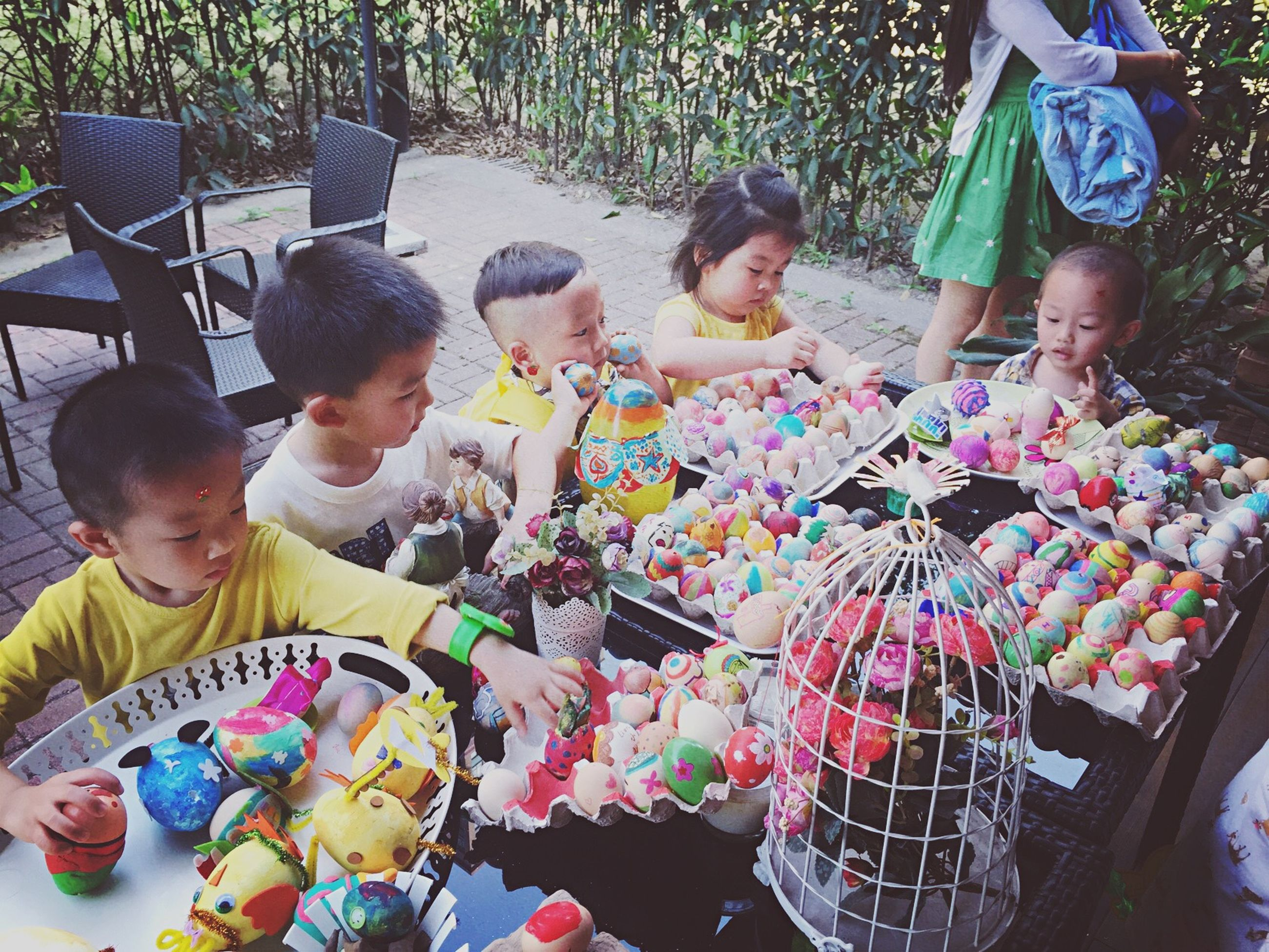 lifestyles, togetherness, leisure activity, childhood, boys, love, bonding, men, elementary age, casual clothing, sitting, holding, friendship, fun, girls, enjoyment, high angle view, playing
