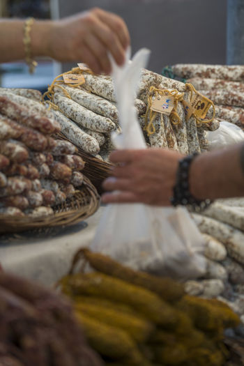 Cropped image of hand holding food at market stall