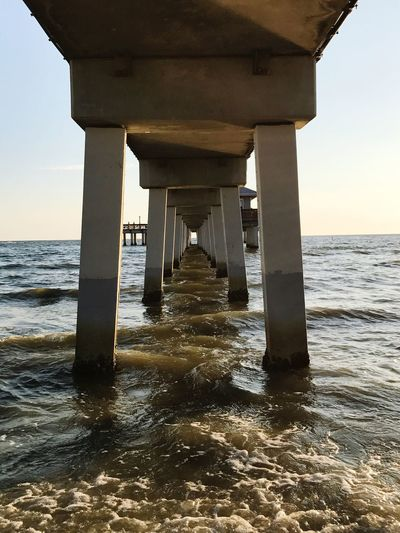 Beautifully Organized Sea Water Beach Horizon Over Water Underneath Nature Pier Below Day Architecture Built Structure Sky Beauty In Nature Outdoors No People Wave Gulf Of Mexico Fort Myers Beach Fresh On Eyeem  EyeEm Gallery Ladyphotographerofthemonth Through My Eyes EyeEm Pier