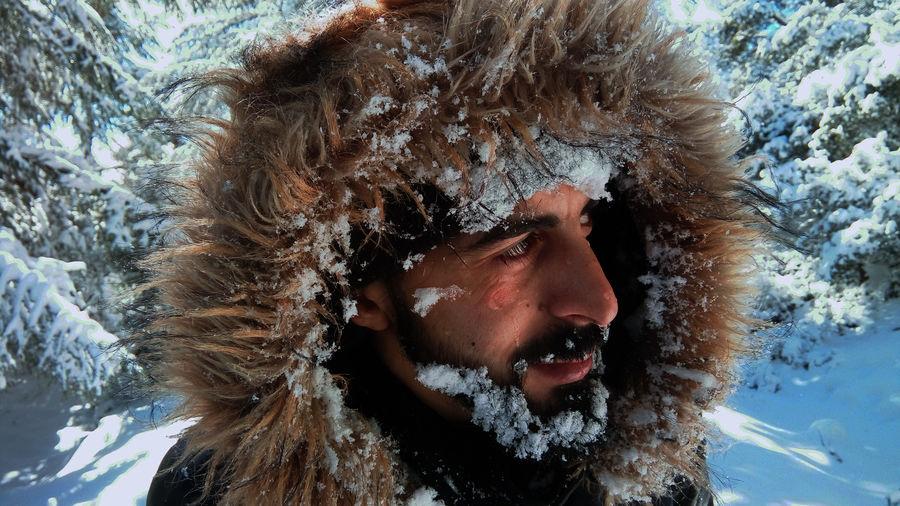 Close-Up Of Man Wearing Fur Coat