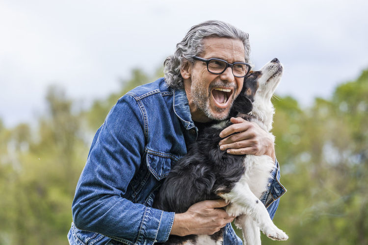 Portrait of a man with dog