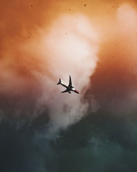 EyeEm Best Edits Airplane Air Vehicle Mode Of Transportation Transportation Airplane Flying Sky Low Angle View Orange Color Journey Cloud - Sky Plane