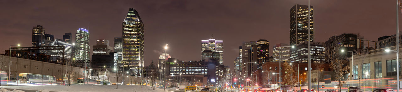 Panoramic view of city lit up at night